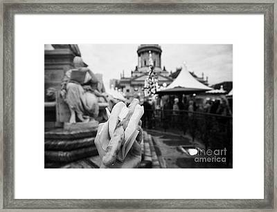 tourists walks around the Gendarmenmarkt christmas market with a rostbratwurst with ketchup and mustard in the late afternoon Berlin Germany Framed Print