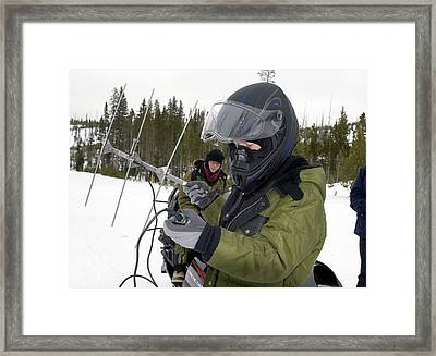 Tracking Radio-collared Wolves Framed Print by Jim West