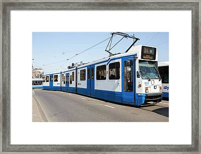 Tram In Amsterdam Framed Print by Ashley Cooper