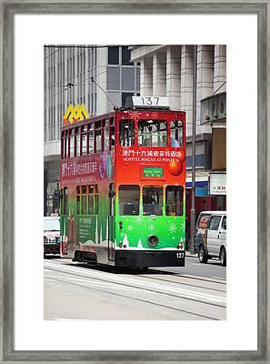 Trams On The Street In Hong Kong Framed Print