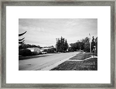 tree lined city street in the town of leader sk Canada Framed Print by Joe Fox