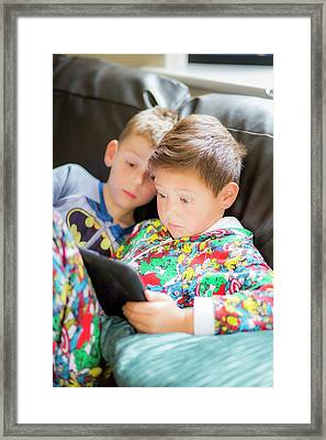 Two Boys Using A Digital Tablet Framed Print