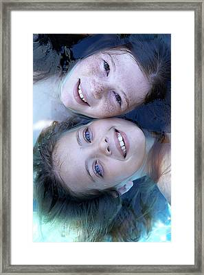 Two Girls Floating In Water Framed Print