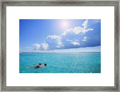 Two People Snorkeling Framed Print by Don Hammond