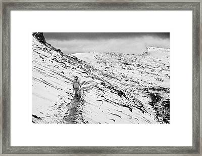two tourists walking along ridge at hannah point penguin colony Antarctica Framed Print