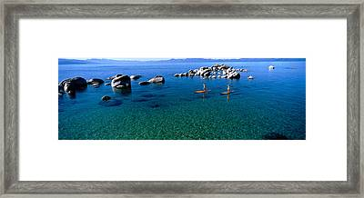 Two Women Paddle Boarding In A Lake Framed Print by Panoramic Images