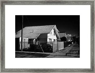 typical chilean construction house with metal tin roof Punta Arenas Chile Framed Print