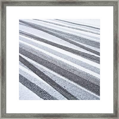 Tyre Tracks Framed Print by Tom Gowanlock