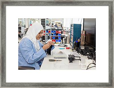 Uav Factory Construction Worker Framed Print by Jim West