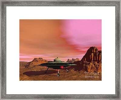 Ufo Landing On A Desert Landscape Framed Print by Elena Duvernay