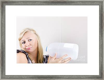 Unhappy Young Woman Holding Empty Milk Bottle Framed Print by Jorgo Photography - Wall Art Gallery