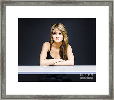 University Student Sitting At Classroom Desk Framed Print