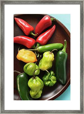Various Chili Peppers On Wooden Plate Framed Print
