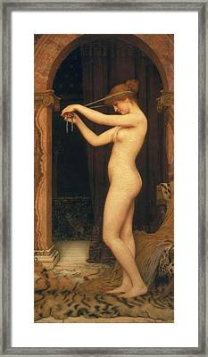 Venus Binding Her Hair Framed Print by John William Godward