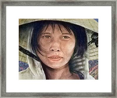Vietnamese Woman Wearing A Conical Hat Framed Print by Jim Fitzpatrick