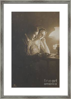 Vintage Loving Couple Reading With Oil Lamp Framed Print by Patricia Hofmeester