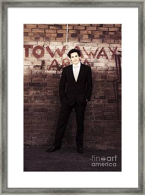 Vintage Salesman Standing In Front Of Brick Wall Framed Print by Jorgo Photography - Wall Art Gallery