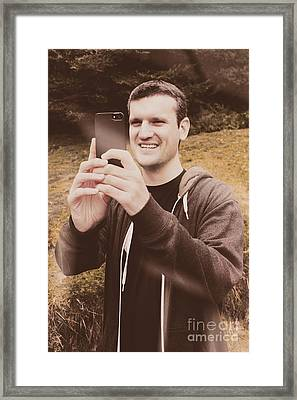 Vintage Traveller Taking Photograph With Phone Framed Print