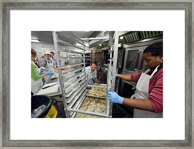 Volunteers At A Community Kitchen Framed Print by Jim West