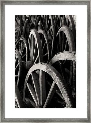 Wagon Wheels Framed Print by John Nelson