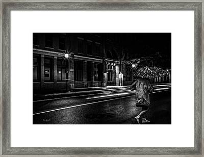 Walking In The Rain   Framed Print by Bob Orsillo