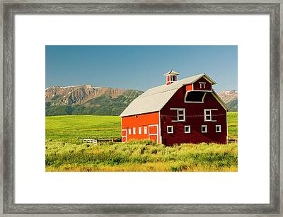 Wallowa Mountains And White Barn Framed Print by Nik Wheeler