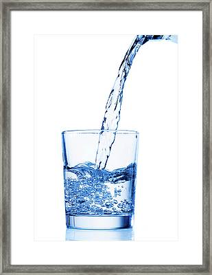 Water Being Poured Into A Glass Framed Print