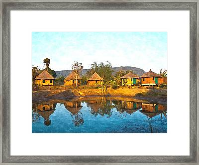 watercolor of bamboo cottages and and thier reflections in pond in Nakorn Ratchasima in Thailand Framed Print