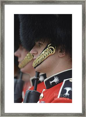 Welsh Guards Stand In Formation Framed Print by Andrew Chittock