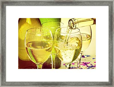 White Wine Pouring Into Glasses Framed Print by Colin and Linda McKie