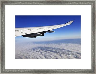Wing Of Flying Airplane Above Clouds Framed Print by Sami Sarkis