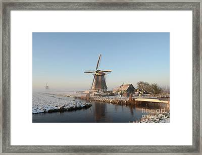 Winter Windmill Landscape In Holland Framed Print