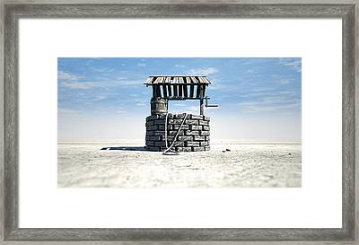 Wishing Well With Wooden Bucket On A Barren Landscape Framed Print