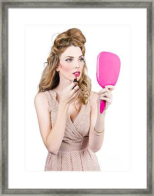 Woman Applying Lip Makeup With Cosmetics Mirror Framed Print