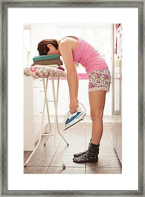 Woman Asleep On Ironing Board Framed Print by Ian Hooton