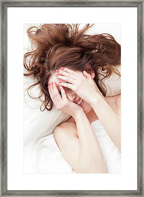 Woman Covering Face With Hands Framed Print by Ian Hooton