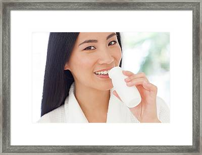 Woman Drinking Health Drink Framed Print by Ian Hooton