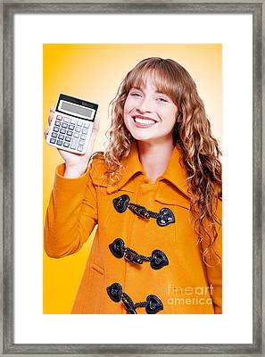 Woman Grinning With Glee Holding Calculator Framed Print by Jorgo Photography - Wall Art Gallery