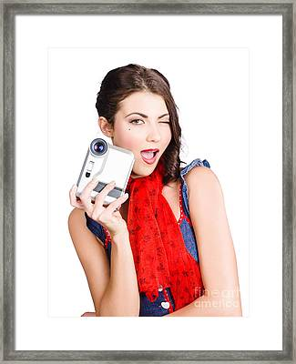 Woman Holding A Home Video Camera. Making Movies Framed Print by Jorgo Photography - Wall Art Gallery