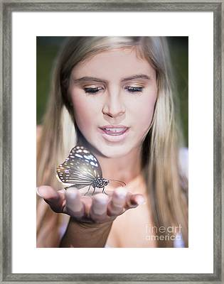 Woman Holding Butterfly Framed Print