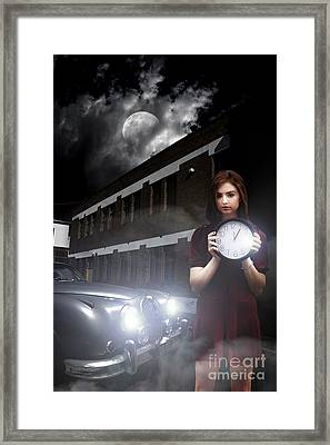 Woman Holding Clock Framed Print