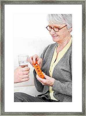 Woman Holding Pill Container Framed Print by Lea Paterson