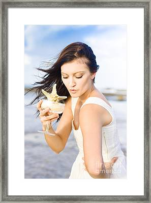 Woman Holding Star Fish Cocktail Framed Print by Jorgo Photography - Wall Art Gallery