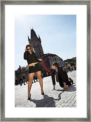 Woman Leads A Man On The Collar Framed Print by Radka Linkova