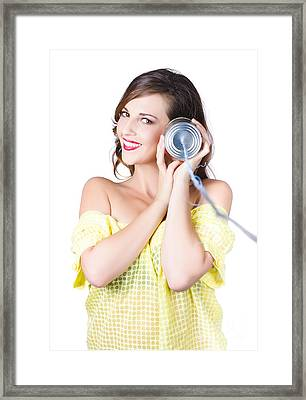Woman Listening With Tin Can Phone To Ear Framed Print by Jorgo Photography - Wall Art Gallery