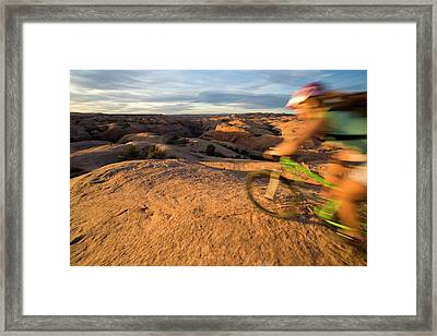 Woman Mountain Biking, Moab, Utah Framed Print