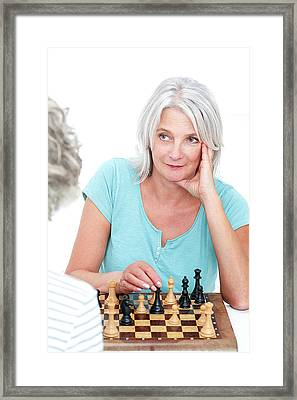 Woman Playing Chess Framed Print
