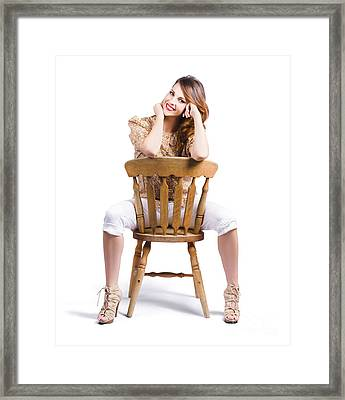 Woman Posing On Chair Framed Print