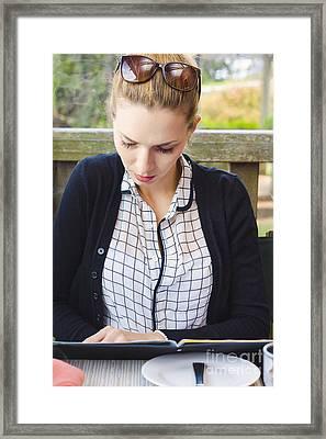 Woman Reading Restaurant Menu At Alfresco Table Framed Print by Jorgo Photography - Wall Art Gallery