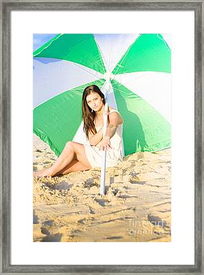 Woman Sitting On Beach With Umbrella Or Parasol  Framed Print